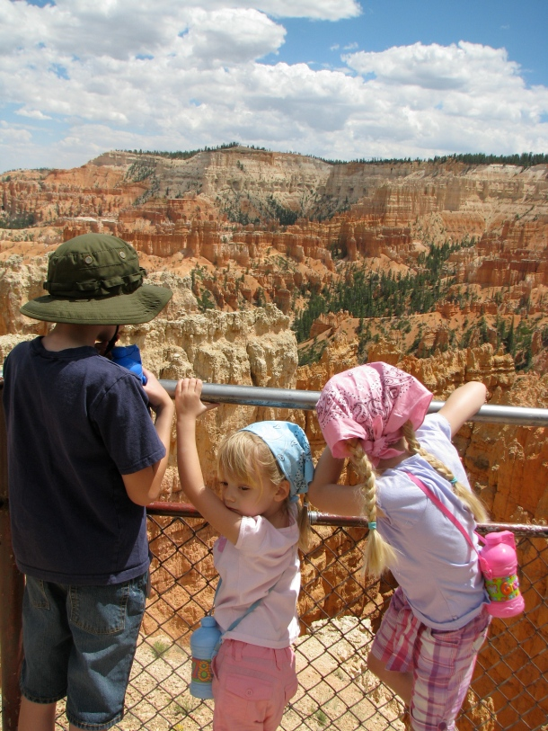 "Kids looking out over Bryce through a ""window"" in the rock."