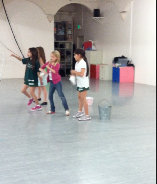 Cute girls practicing their musical number. My girl is the only blonde.