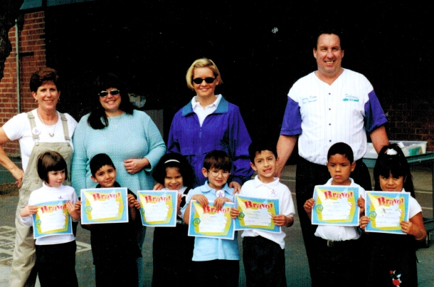 Me in my purple and aqua Fairgrove sweatsuit on award day in kindergarten. Circa 1998?