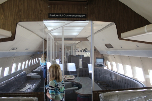 Inside Air Force One, the meeting room.
