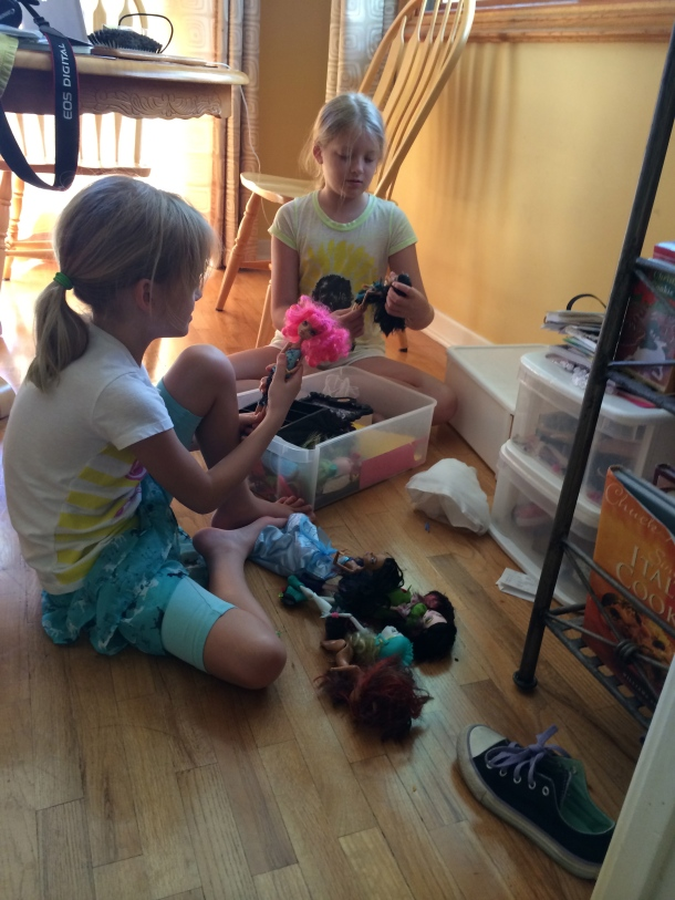 I asked the girls to go through their dolls to give some away and they ended up playing together.