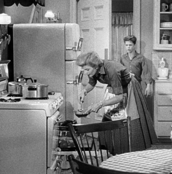 June Cleaver, making dinner before Ward comes home.