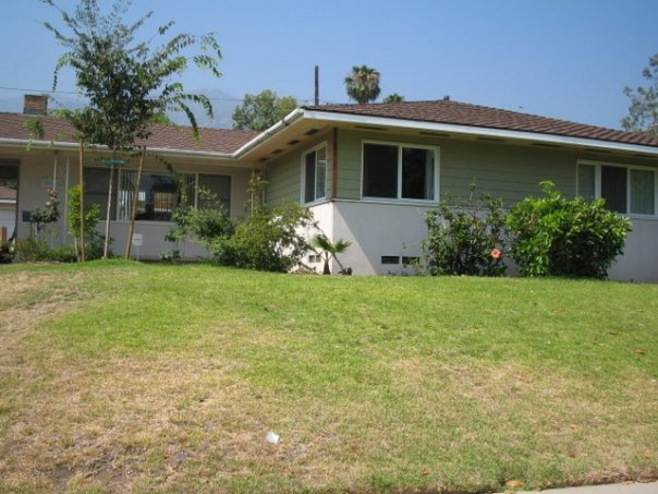 Our current house, after we redid the siding and put new windows in the room on the corner.