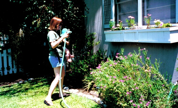Me (and Sean) watering the plants at our first house.