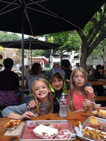 Silly kids enjoying their lunch.