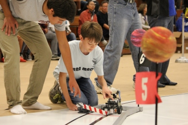 My son, at a robotics competition.